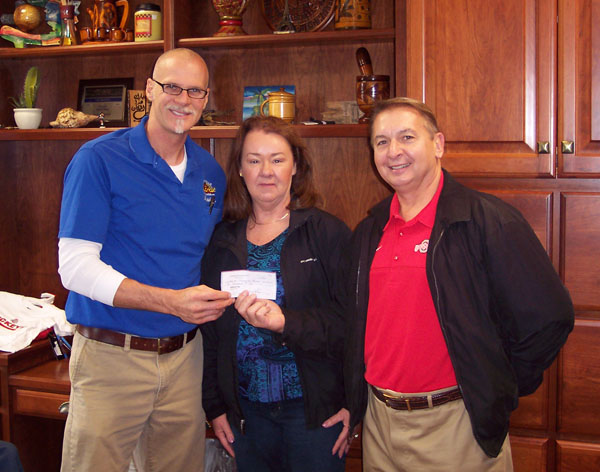 Walt and Pat present EBR donation check to Hartville Flea Market